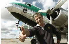 Iron Maiden lead singer Bruce Dickinson in front of Buffalo Airways DC3 from Ice Pilots NWT at Hay River, NWT.