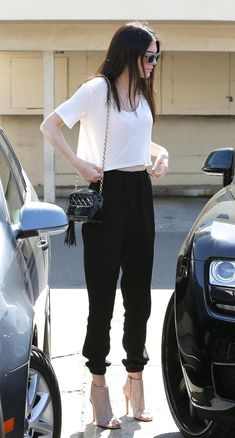 Kendall Jenner wearing Chanel Black Patent Leather Tassel Crossbody Shoulder Bag, Jean-Michael Cazabot Ophelia Open-Toe Bootie and Celine Cl 41804-S Matrix Slo-70.