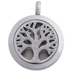"""NEW! Essential Oil Locket Tree Of Life: Engage your senses and your unique style with this gorgeous piece. Place a Scent-able Coin into your locket, then add a few drops of your favorite essential oil to the coin to create a natural, mood-boosting accessory! This lovely locket includes three White Scent-able Coins and an 18"""" chain. Essential oil not included. $21"""