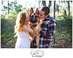 Couples pose engagement dog love