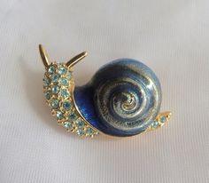 Pretty blue rhinestone and metallic enamel snail brooch by arepaki.etsy.com
