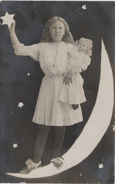 Alice with Her Doll Standing on the Moon - A Real Photo Postcard by Photo_History, via Flickr
