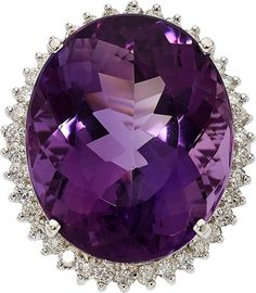 Amethyst, Diamond, White Gold Ring The ring features an oval-shaped amethyst measuring 25.63 x 21.16 x 14.97 mm and weighing approximately 43.00 carats, framed by full-cut diamonds weighing a total of approximately 0.95 carat, set in 14k white gold. Gross weight 20.80 grams.