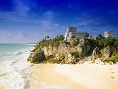Tulum Beach, Mexico.  One of the first resorts in Mexico and one of the last cities inhabited and built by the Mayans. Ruins are situated on 39ft cliffs along the east coast of the Yucatán Peninsula on the Caribbean Sea in the state of Quintana Roo, Mexico. The beach is also a breeding ground for sea turtles.