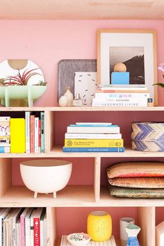 colorful pink wall with bookshelves