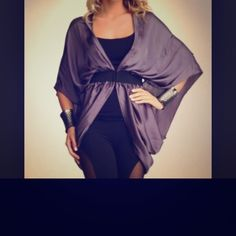 Bebe kimono Bebe purple silk elastic waist kimono top. Very versatile. Can be paired with slacks for a more casual look or with a tube top dress for a more elegant affair. Worn but in good condition bebe Tops Blouses