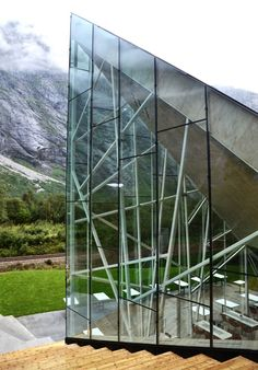 The jagged glass edges of this restaurant by Norwegian studio Reiulf Ramstad Architects point up towards a sheer cliff face.