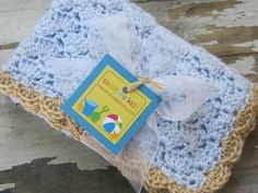 Pale Blue and Tan Seashell Crochet Baby Boy Blanket/Photography Prop/Shower Gift. $35.95, via Etsy.