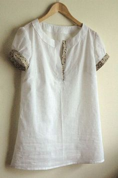 Once the tunic Was Over, I gave a big pair of scissors in the neck for a placket (and taking a deep breath), and voila!