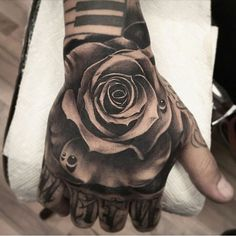 Grayscale rose hand tattoo by Fred Flores at Inkslingers Tattoo in Alhambra, California.