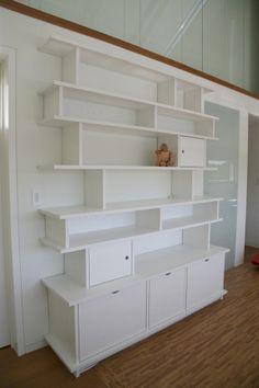 Custom Bookshelf and Storage Unit by Jennifer Ward, via Behance
