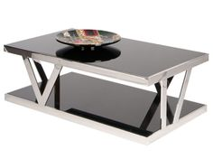 Dania - The Berden coffee table features two-tier black glass shelves with a chrome frame. Unique and super sleek.