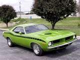 this is my dream car a Baracuda hemi 70 green with black billboard racing stripes