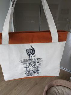 Sac Madison orange et blanc illustré cousu par Magalie - Patron Sacôtin