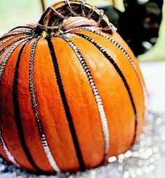 Sequin Ribbon Decorated Pumpkins. Might make a nice contrast with some of the other ideas with the lace and ribbons for varying textures.