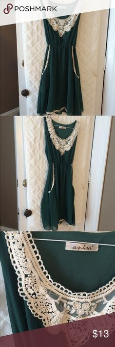 EMERALD GREEN chiffon and crochet dress Beautiful emerald green chiffon dress with crochet detail and pockets! Ties in the back. Two minor flaws pictured: small, non-noticeable snags on the ties. Can not be noticed when worn!! Beautiful dress and very flattering. Purchased from a boutique in LONDON. Price reflects the flaws. Dresses