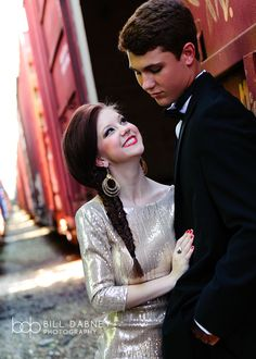 formal fashion prom seniors couple railroad tracks train tux tuxedo glamour