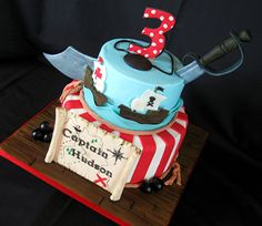 """Pirates! - Buttercream with fondant and gumpaste accents. 9"""" and 6"""" tiers."""