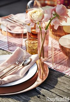 COLORED GLASS For a rooftop dinner party, echo the setting sun with rose-colored tableware, like this serene urban oasis designed by Laurie Blumenfeld-Russo.