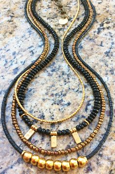 Holiday Inspired Long Black Onyx, Bronze and Gold Charm Necklace $225 Click to purchase