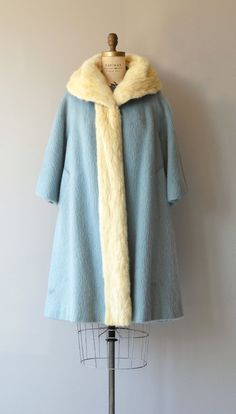 Stunning vintage 1960s Lilli Ann baby blue mohair winter coat with cream mink collar extending the length of the coat, 3/4 sleeves, swingy shape and