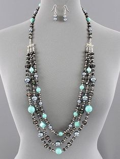 Beautiful triple layered beaded necklace with Turquoise dyed Howlite gems, grey pearls and black faceted crystals.  Beads range from about 6mm-14mm.  Pretty silver stations take this multi strand down to one for easy on and off over the neckline.  Tons of beads on this and tons of sparkle!  This ... #longbeadednecklaceblack