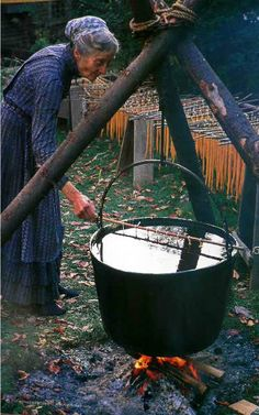Tasha Tudor dipping her candles in tub of hot wax on her 450 acre farm in Vermont, built by her son, Seth, with hand tools. She lived in her Vermont farmhouse with no water, electricity and she raised her 4 children there after she divorced her two husbands. Beeswax candle dipping.