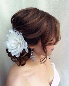 low bun bridal hair with flower