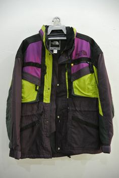 Vintage The North Face jacket. Made in Japan. Good used condition. 8/10. Please enlarge the photos to get clear.  Body 100% nylon. Front collar 100% polyester. Lining 100% nylon.  Measurement taken while laying flat.  Pit to pit - 26 inches Shoulder to shoulder - 23 inches Length - 30 inches Sleeve length from shoulder - 23 inches  Please compare the measurement with your garment. Kindly read my shipping and policies. Thanks for dropping by. Have a nice day.  NV-850
