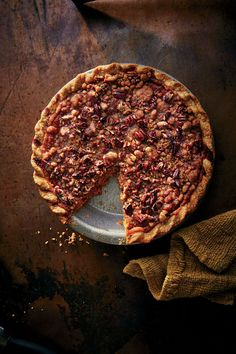 Pumpkin-Praline Pie | If you can't decide between pecan and pumpkin pie, this dessert will give you a taste of both in one slice. A quick brown sugar–pecan streusel tops the pie after it bakes; the topping will set into a crunchy layer as the pie cools. Be sure to use a standard 9-inch pie plate rather than a deep-dish one to ensure an evenly baked crust.