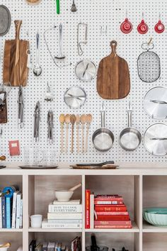 Inspired by the utility of restaurant kitchens, a pegboard in Cook Space in Brooklyn keeps kitchen tools within reach. See The Effortlessly Cool Chef's Apartment: 9 Ideas to Steal from Cook Space in Brooklyn for more. Photograph by Sean Santiago. Pegboard Organization, Small Kitchen Organization, Kitchen Storage, Storage Organizers, Kitchen Pegboard, Kitchen Tools, Garage Storage, Kitchen Gadgets, Organization Ideas