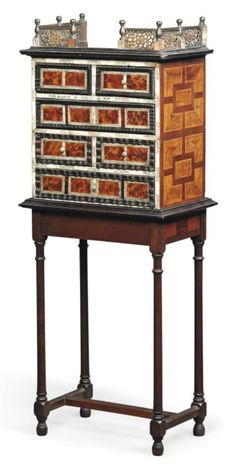 A PERUVIAN TORTOISESHELL AND BONE INLAID CABINET LATE 17TH CENTURY On a later stand 49½ in. (125 cm.) high; 19 in. (48 cm.) wide; 12 in. (36 cm.) deep