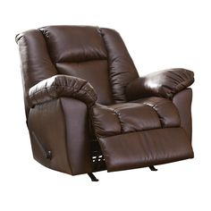 Cozy up in the Knoxton Brown Faux Leather Big Man Rocker Recliner from Ashley Furniture. Covered in durable performance fabric with the look of leather. Padding over the chaise provides support behind the knees. Wood and metal frame. The best spot for finishing a long novel or binge-watching your favorite TV show. Ashley Knoxton Brown Faux Leather Big Man Rocker Recliner | Furniture and Mattress Outlet