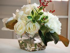Features:  -Square glass vase.  -Permanent botanical.  -Faux floral.  -Realistic.  -Home decor.  Product Type: -Centerpieces.  Color: -Whites.  Size: -Medium.  Flower: -Hydrangeas/Roses/Mixed.  Contai