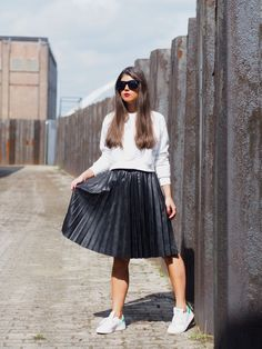 The black leather pleated skirt
