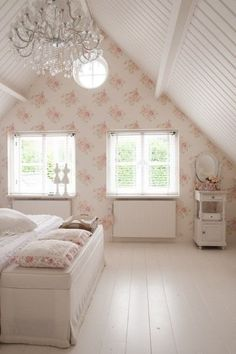 Attic bedroon: floor boards painted white, white beadboard ceiling