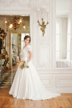 I LOVE this dress!!! lookd at the shoulder sleeves!!!  Pure Beauty - Modest Wedding Gown