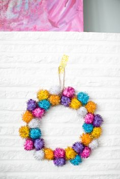 A DIY pom pom wreath you'll want to leave up all year.