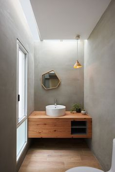 The mirror, light, basin, walls, love this space. //  Gallery of House H / HAO Design - 30