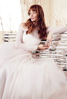 Modern Winter Wedding Dress: Blush silk long-sleeved gown with a full organza skirt, Le Spose Di Giò