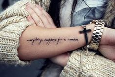 "Little forearm tattoo saying ""everything happens for a reason""."