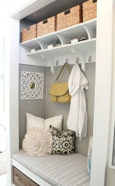 Most awesome mudroom or foyer closet reno I've seen - remove doors, install shelves/hooks/seat and go!