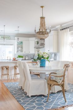 Saw Nail Paint Seattle Home Tour - Cottage Farmhouse White Kitchen Round Dining Table Slip-covered Parsons Chairs Wood Bead Chandelier