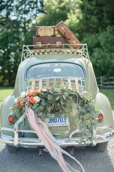 A pretty vintage getaway car: http://www.stylemepretty.com/canada-weddings/2016/02/04/peaches-cream-wedding-inspiration/ | Photography: Krista Fox - http://kristafox.com/