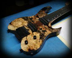 Kiesel Guitars Carvin Guitars  V7 (Vader headless Series) Buckeye burl top and black limba body with Lithium pick ups and Hipshot bridge