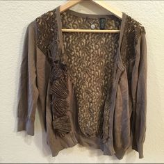 BKE Boutique Cardigan BKE Boutique brand brown cardigan. Features lace all around the front and back, with accordion folded lace embellishments on the right hand side (photo 2). Small metal click together buttons for closure. Size large. BKE Sweaters Cardigans