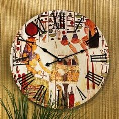 Image from the tomb of Queen Nefertiti, Valley of the Queens, Luxor, 19th dynasty ; Once part of a grand staircase mural during the reign of Ramses II, our historic Egyptian image of the Queens offering to her goddess graces the face of this easy-to-read, quality wall clock. The classic Egyptian styling is punctuated with two black metal hands surrounded by bold numerals to mark the hours. Requires one AA battery.