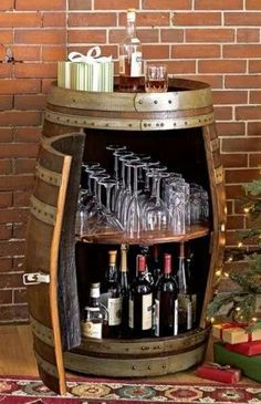 Wine barrel bar table and many other DIY furniture made from wooden barrels . build your own wooden barrel diy furniture wine glasses storage space wine bottles More ideas like this project @ co. Wine Barrel Bar Table, Wine Barrels, Whiskey Barrel Bar, Wine Barrel Crafts, Diy Furniture Making, Furniture Ideas, Furniture Dolly, Cabinet Furniture, Furniture Inspiration