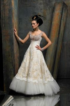 Color: Ivory/Silver  Silk shantung and Alençon lace A-line gown with scoop neckline and intricately beaded bodice encrusted with Swarovski ...