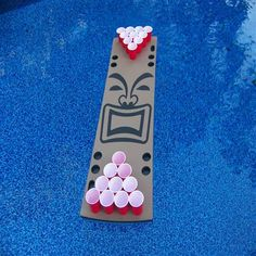 This is our 10 cup tan tiki guy table
